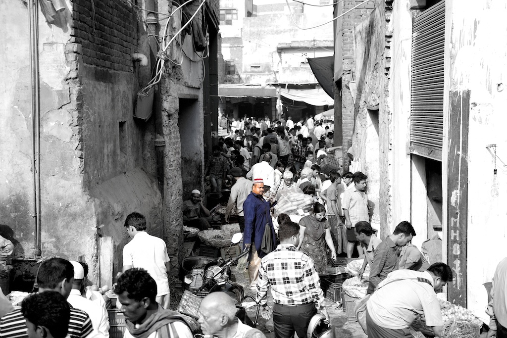 Lone man in a crowded market on way to Jaipur from Delhi