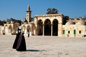 Two Iman's walk across the court yard of Temple Mount (Jerusalem, Israel)