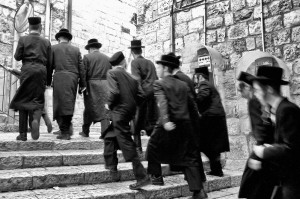 A group of Hasidic Jews race up to Temple (Jerusalem, Israel)