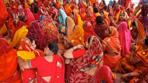 Colourful ladies sit waiting for a reading from the Bhagavad Gita on a festival day (Outside Jaipur, India)