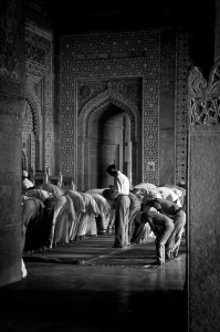 Group prays at the Fatehpur Sikri mosque (Lost city of Fatehpur Sikri, India)