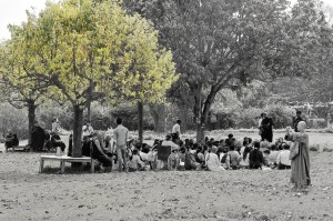 Group sits under a tree listening to a monk (Lumbini, Nepal)