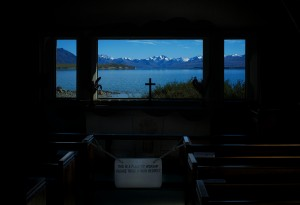 Interior of the Church of the Good Shepard looking out towards Lake Tekapo and the mountains beyond. South Island, New Zealand.