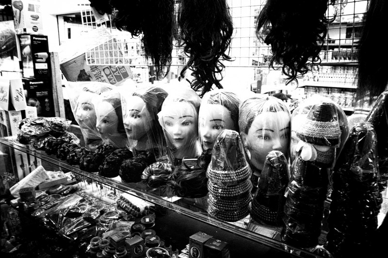 Should you lose your head on this busy Friday, you can always buy a new one Laotian market (Vientiane, Laos)
