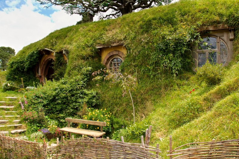 Not a nasty, dirty, wet hole, filled with the ends of worms and an oozy smell, nor yet a dry, bare, sandy hole with nothing in it to sit down on or to eat: it was a hobbit-hole, and that means comfort. (Hobitton, New Zealand)