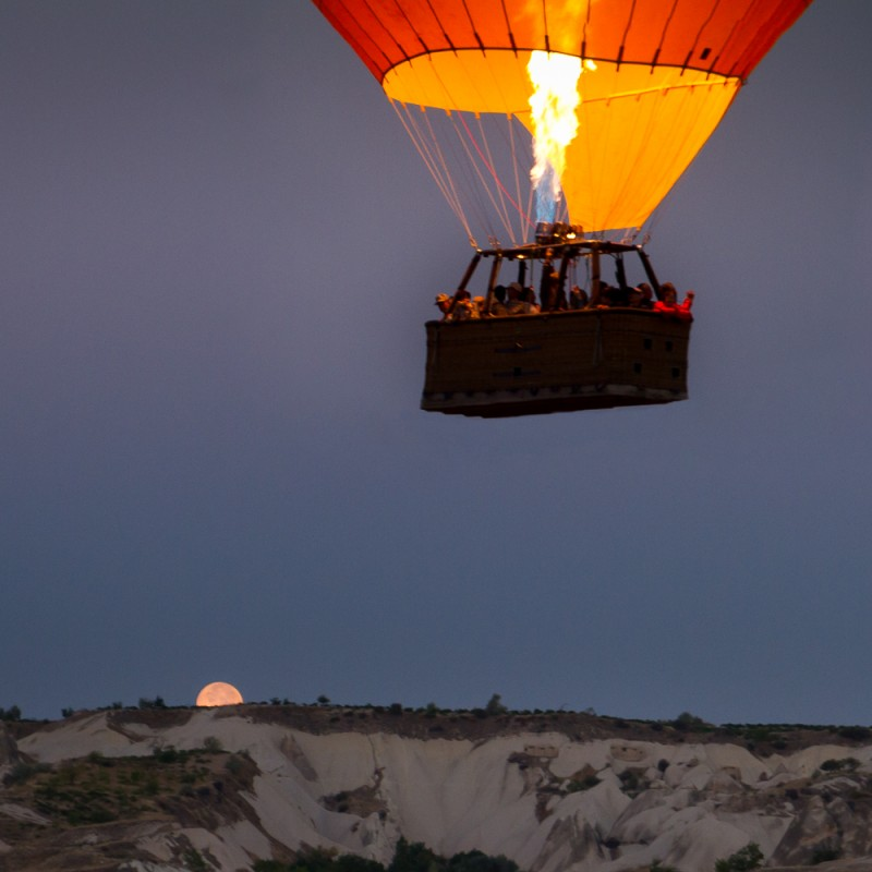 Moon sets as we embark on an early morning balloon flight in Cappadocia, Turkey